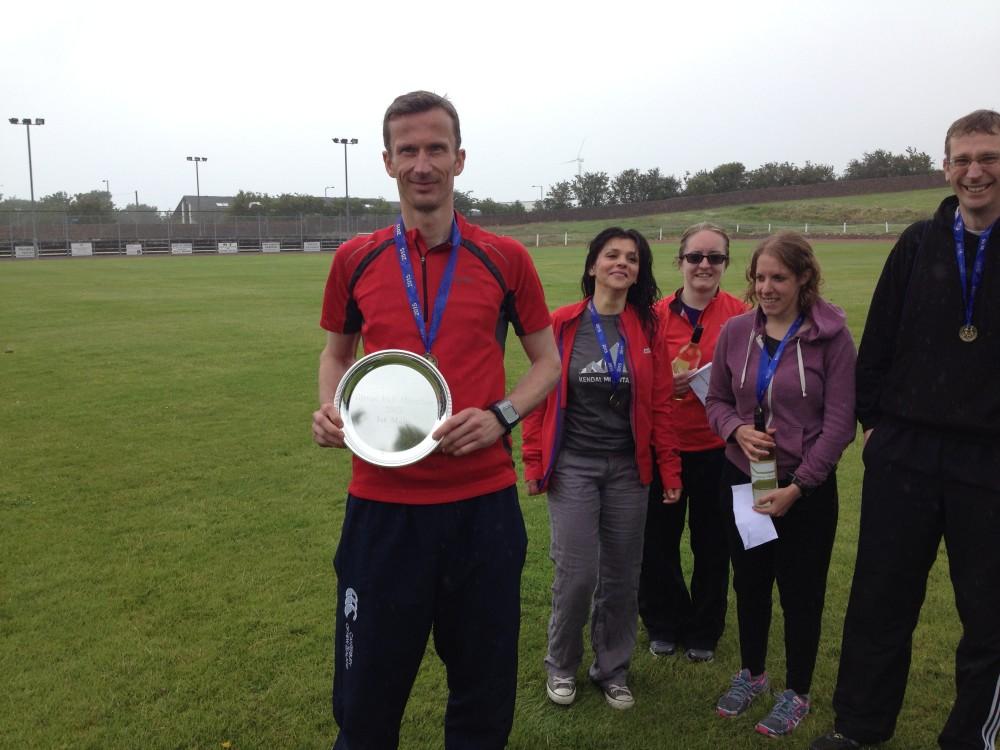 Glasgow marathoner Bruce Carmichael holding trophy.