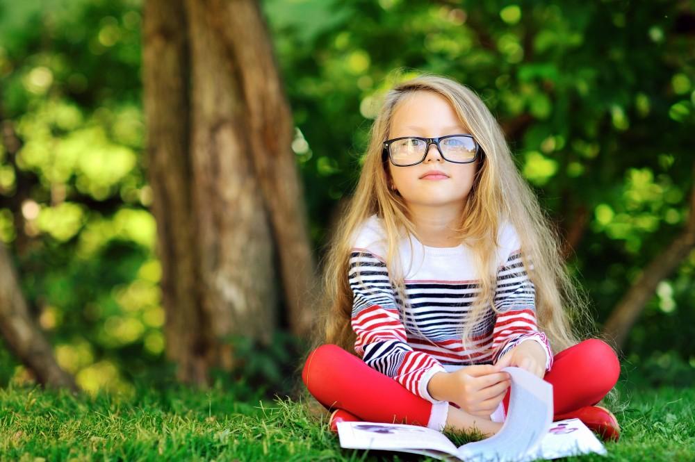 Little girl reading a book to illustrate Glasgow PR consultancy Zude PR's post.